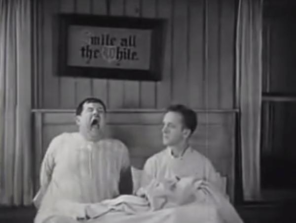 They Go Boom! Oliver Hardy sneezing keeps Stan Laurel awake
