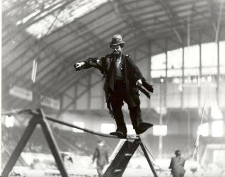 Photo of Emmett Kelly walking the wire as Weary Willy
