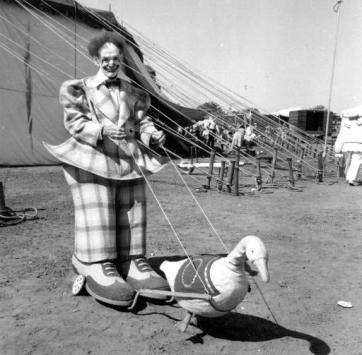 Paul Wenzel, Riingling Brothers clown, in one of his props apparently being pulled by a duck