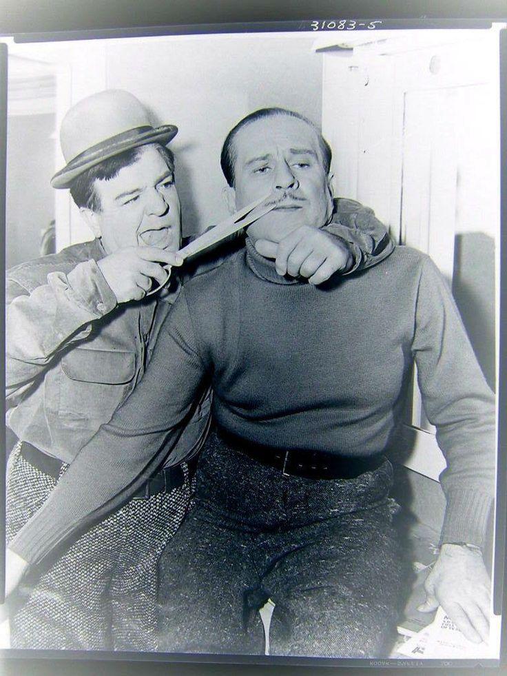 Lou Costello trims Bud Abbott's mustache