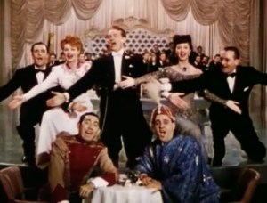 Color photo from Du Barry Was a Lady, featuring the entire cast – Gene Kelly, Lucille Ball, Red Skelton, Virginia Mayo, Rags Ragland, Zero Mostel