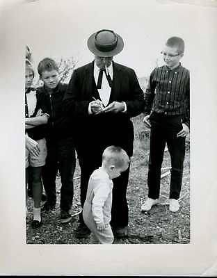 Buster Keaton signing autographs