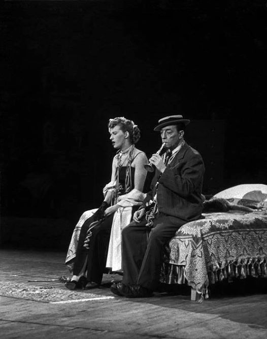 Buster Keaton and lady sitting on a bed