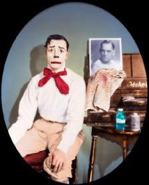 Color photo of Buster Keaton in whiteface clown makeup