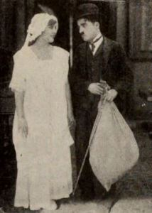Police - Edna Purviance and Charlie Chaplin (Charlie holding a bag full of goods stolen from her)