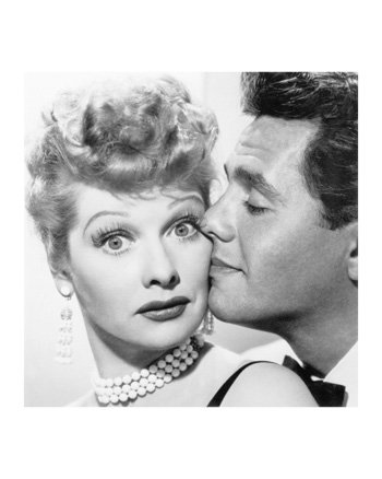 Lucille Ball being kissed by Desi Arnaz