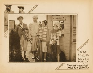 "Lobby card for Should Married Men Go Home? Stan Laurel and Oliver Hardy on the golf course with their ""dates"""