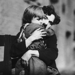 Charlie Chaplin and The Kid hugging