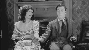 Buster Keaton holds hands with The Girl