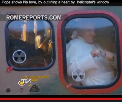 Pope trace heart on helicopter window