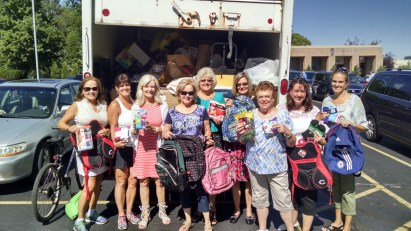 Cincinnati Ohio USA Ladies Of Charity (AIC) sending children to school with new socks 2014