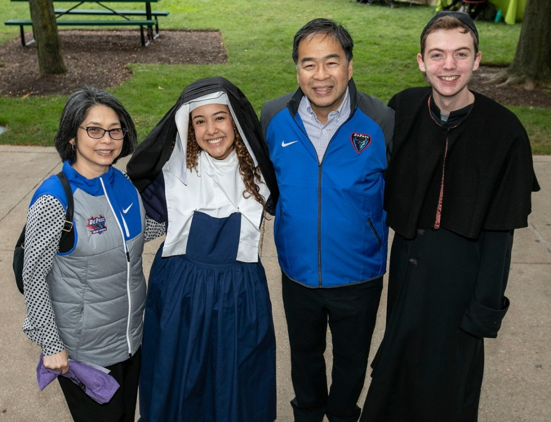 Josephine Esteban, Gisselle Cervantes, A. Gabriel Esteban, president of DePaul, and Jack Evans pose for a photo on the Lincoln Park Campus Quad, Friday, Sept. 28, 2018, during the annual Vinny Fest. Cervantes and Evans were portraying Louise de Marillac a