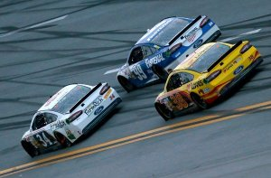 NASCAR river David Ragan (34) passes Carl Edwards (99) with the help of teammate David Gilliland (38) on the last lap at Talladega Superspeedway, May 5, 2013  Photo - Kevin C. Cox / Getty Images