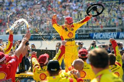 Joey Logano, driver of the #22 Shell-Pennzoil Ford, celebrates in Victory Lane after winning the NASCAR Sprint Cup Series 44th Annual Pure Michigan 400 at Michigan International Speedway on August 18, 2013  Photo - Jared C. Tilton/Getty Images
