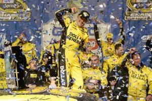 Matt Kenseth, driver of the #20 Dollar General Toyota, celebrates in victory lane after winning the NASCAR Sprint Cup Series Geico 400 at Chicagoland Speedway on September 15, 2013  Photo - John Harrelson/Getty Images