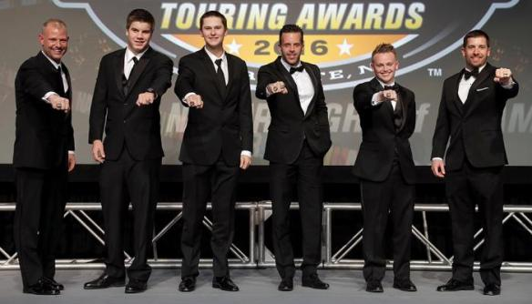 From left, Burt Myers, Cayden Lapcevich, Todd Gilliland, Anthony Kumpen, Justin Haley and Doug Coby show off their NASCAR championship rings at the end of Saturday's NASCAR Touring Series Night of Champions at the Charlotte Convention Center. Photo - Getty Images