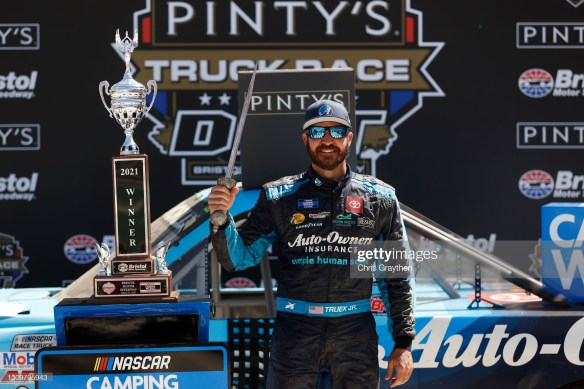 Martin Truex Jr. wins the NASCAR Pinty's Truck Race on Bristol Dirt in the rain-delayed event on Monday afternoon at Bristol Motor Speedway.