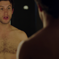 "Rob Heaps as Ezra Bloom and Parker Young as Richard shirtless in Imposters 1x02 ""My Balls, Dickhead"""
