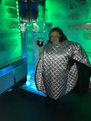 Gremila baring the elements in the ice bar. Photo by Willie Fryson