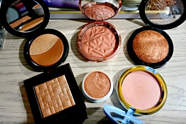 Best of 2015 Highlighters:Make Up For Ever Pro Sculpting Duo 2 Golden, Becca Blushed Copper Shimmering Skin Perfector, Ruby Kiss Bronze Glow All Over Glow Bronzer, ColourPop Avalon Super Shock Cheek, Bobbi Brown Bronze Glow Highlight Powder, MAC Cinderella Coupe D'Chic Iridescent Pressed Powder