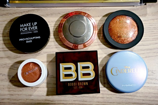 Best of 2015 Highlighters: Make Up For Ever Pro Sculpting Duo 2 Golden, Becca Blushed Copper Shimmering Skin Perfector, Ruby Kiss Bronze Glow All Over Glow Bronzer, ColourPop Avalon Super Shock Cheek, Bobbi Brown Bronze Glow Highlight Powder, MAC Cinderella Coupe D'Chic Iridescent Pressed Powder