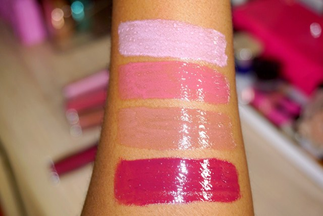 Butter London Fancyfull Lippy Liquid Lipstick Set Swatches on Dark Skin Tickled Pink, Dahling, Spiked Cocoa, Mulled Wine
