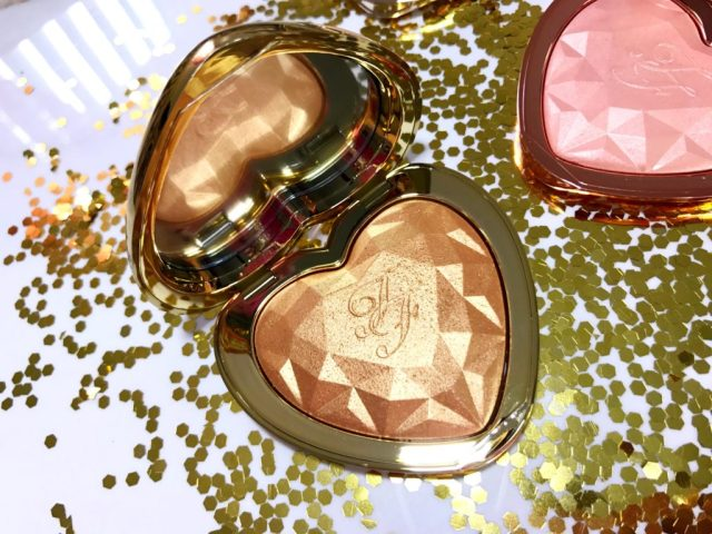 Too Faced Love Light Prismatic Highlighter You Light Up My Life Swatches on Dark Skin