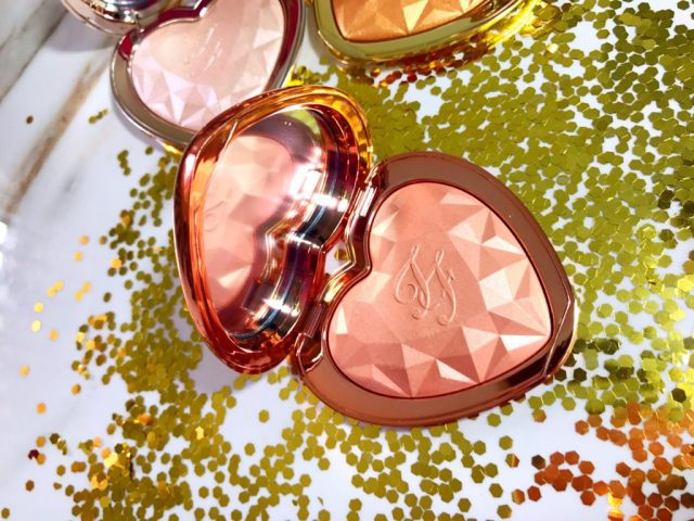 Too Faced Love Light Prismatic Highlighter Ray of Light Swatches on Dark Skin