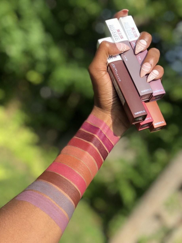 Maybelline SuperStay Matte Ink Liquid Lipstick Swatches on Dark Skin: 15 Lover, 40 Beliver, 45 Escapist, 50 Voyager, 70 Amazonian, 75 Fighter, 80 Ruler, 85 Protector, 90 Huntress, 95 Visionary
