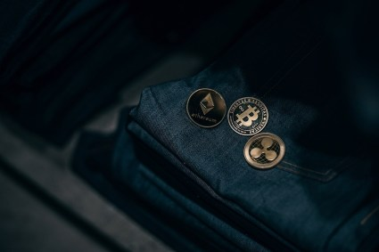 Gold-Cryptocurrency-Coins-Laying-on-Top-of-Denim-Jeans-min