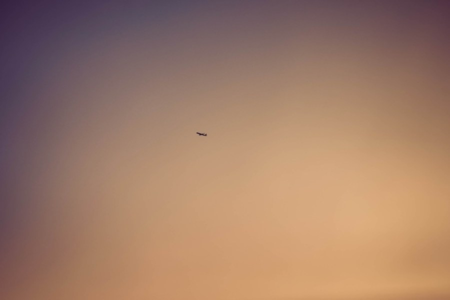 Airplane-Flying-Away-in-the-Sunset