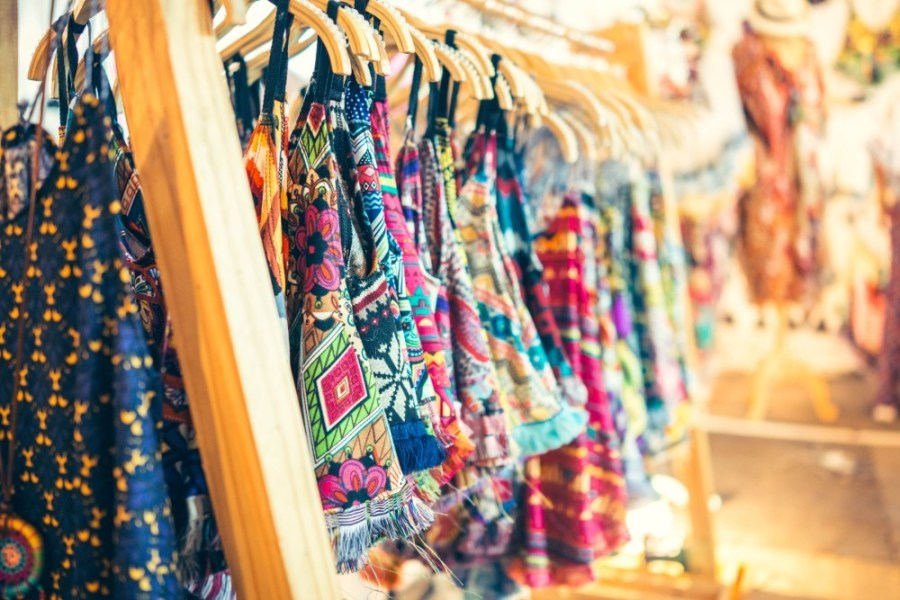 Colorful-Dresses-and-Shirts-Hanging-on-Hangers