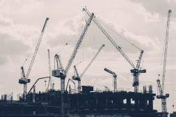 Many-Construction-Cranes-Surrounding-a-Building-in-Bangkok