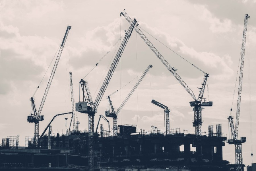 Many-Construction-Cranes-Surrounding-a-Building-in-Bangkok