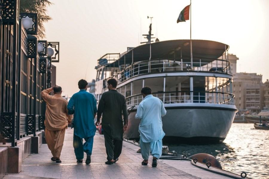 Men-Walking-next-to-the-Dubai-Canal