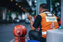 Motorbike-Taxi-Driver-on-a-Cigarette-Break