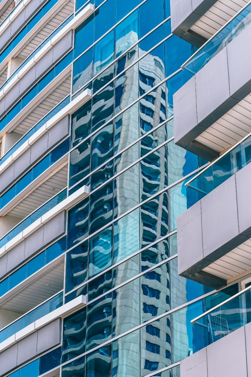 Reflections-of-a-Modern-Building-on-the-glass-windows-of-another-Building-in-Dubai