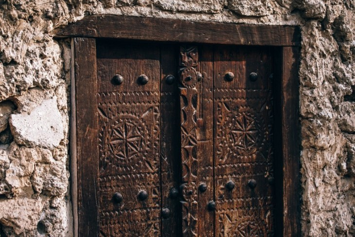 Vintage-Wooden-Door-with-Carved-Symbols