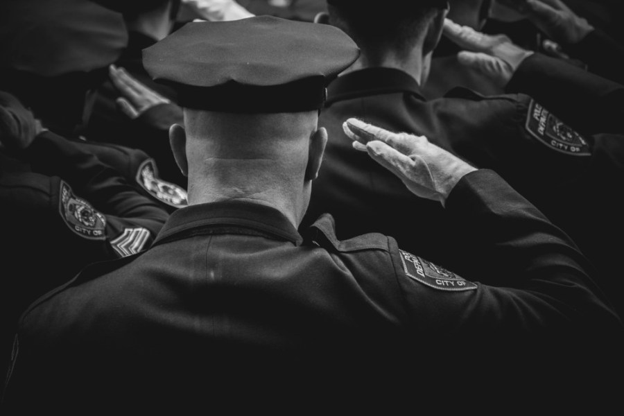 Black-and-White-Photography-of-a-Police-Officer-Giving-Honor