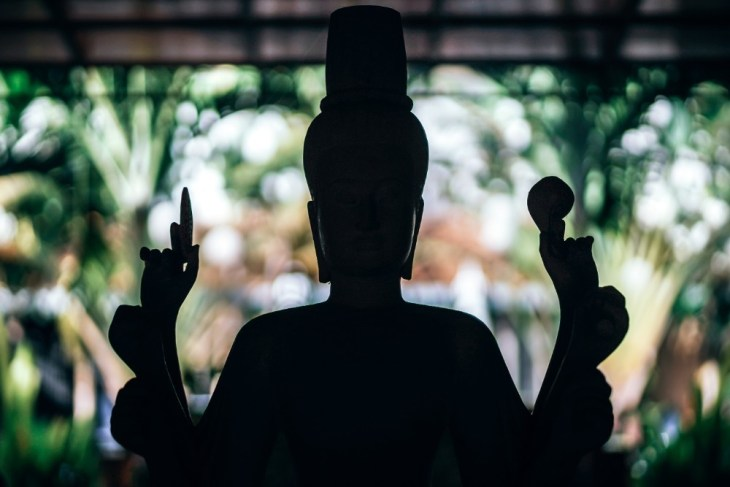 Silhouette-of-a-Buddha-Statue-at-a-Resort-in-Siem-Reap-Cambodia