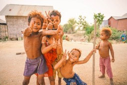 Small-Cambodian-Kids-Smiling-and-Showing-Thumbs-Up-to-the-Camera