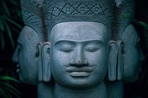 Three-Headed-Buddha-Statue-inside-a-Zen-Garden-in-Cambodia