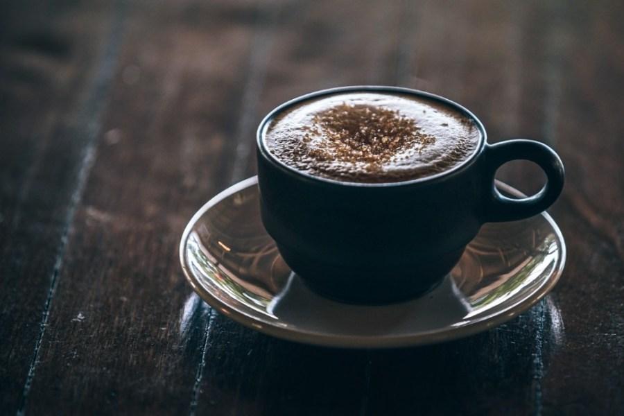 Close-up-Shot-of-Coffee-inside-a-Black-Mug