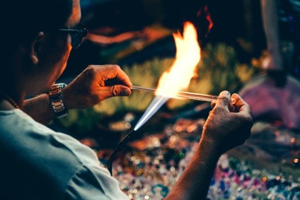 Close-up-Shot-of-a-Man-Making-Glass-Jewelry