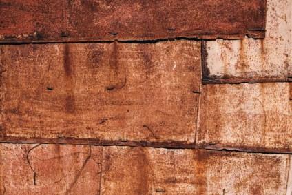 Close-up-Shot-of-a-Rusty-Wall