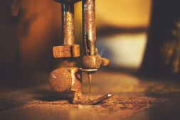 Close-up-Shot-of-an-Old-Rusty-Sewing-Machine-Needle