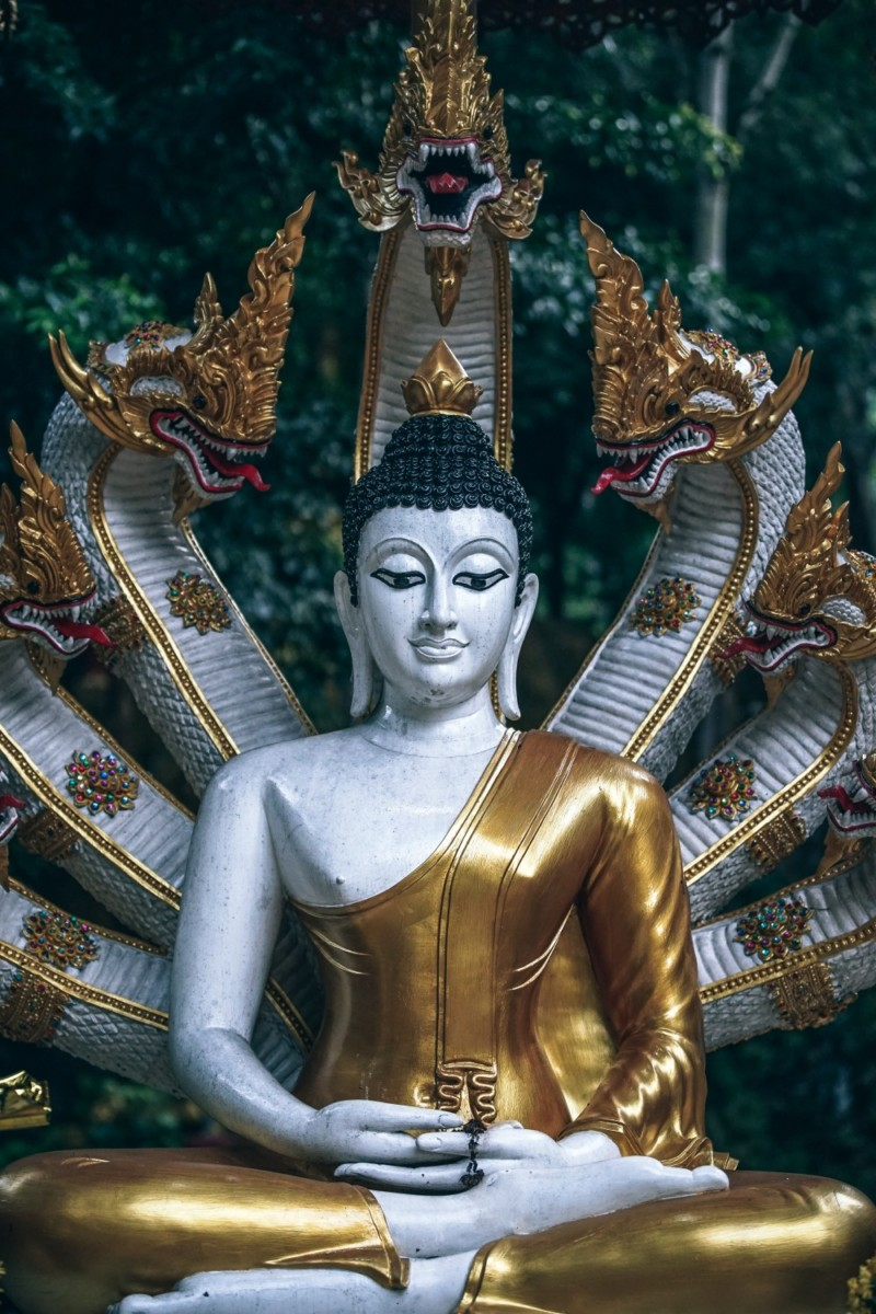 Gold-and-White-Buddhist-Statue-with-Multiple-Snake-Heads