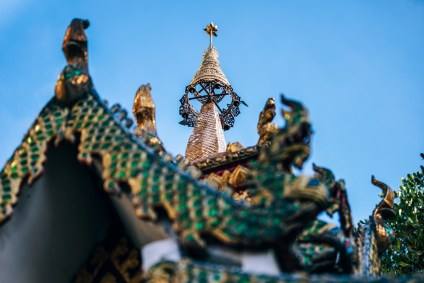 Golden-Tip-of-a-Dragon-Temple-with-the-Blue-Sky-in-the-Background