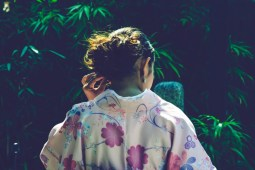 Japanese-Woman-Photographed-in-front-of-Dark-Green-Plants