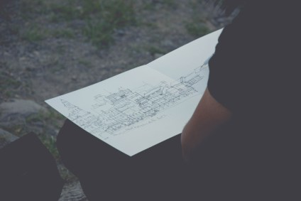 Man-Drawing-an-Architecture-Sketch-on-a-Piece-of-Paper